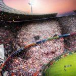 Montaje de tu foto ampliada en las tribunas de un estadio