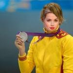 Deportistas ganadora de medalla olímpica en tu fotomontaje